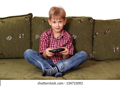 boy sitting on bed and play video game