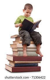 Boy sitting on a big pile of books and reading
