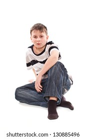 boy sitting on the floor on a white background