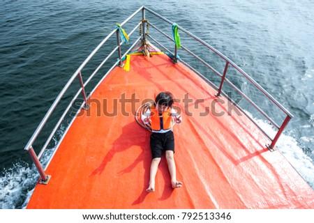 Boy Sitting On Orange Fishing Boat Stock Photo Edit Now 792513346