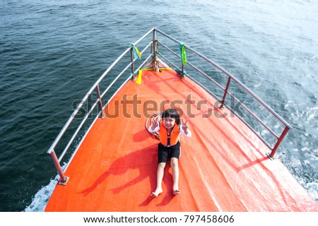 Boy Sitting On Orange Fishing Boat Stock Photo Edit Now 797458606
