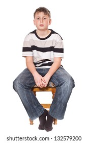boy sitting on a stool on a white background