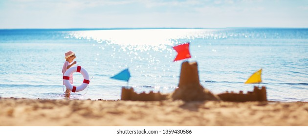 boy sitting smiling at the beach