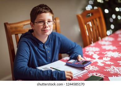 Boy sitting at table doing his homework