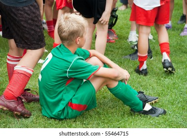 boy sitting tired after the game