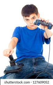 boy sitting with two joysticks and plays