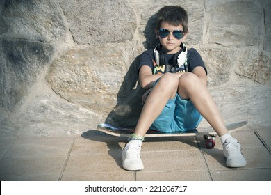 boy with skateboard street fashion, youth and lifestyle