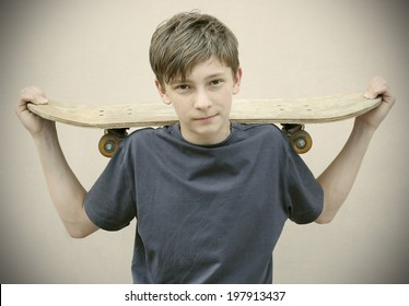 boy with Skateboard wearing Vintage photos retro style