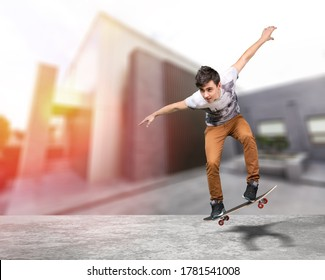 Boy skater jumping on a skateboard at the street