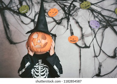 boy in skeleton costume at halloween party