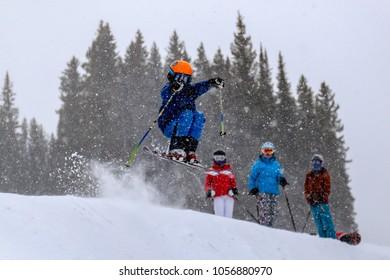 boy skiing in the snow in Aspen, Colorado