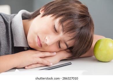 boy sleeping in class