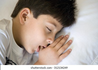 Boy sleeping with thumb in his mouth
