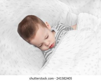the boy sleeps, with snowflakes