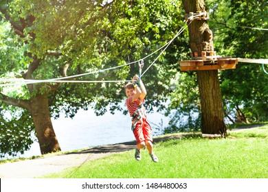 Boy slide at rope park easy low zip line for kids