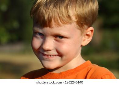 boy sly face outdoor