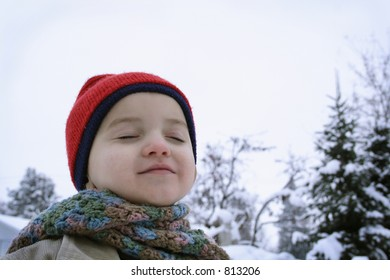 Boy Smiles into the sky on a snowy day.- SOME NOISE