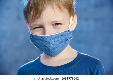 Boy smiles in a protective mask against viruses