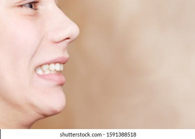 A boy smiles and showing malocclusion of teeth and going to go to the orthodontist to put braces for teeth alignment. Dental concept. Copy space