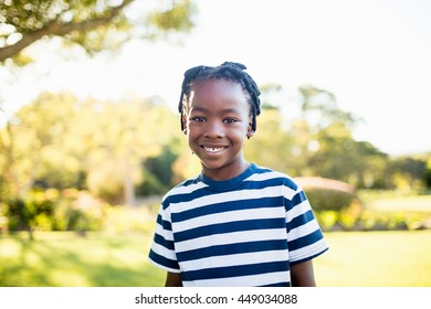 Boy smiling in front of the camera at park