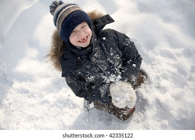 Boy with a snowball.