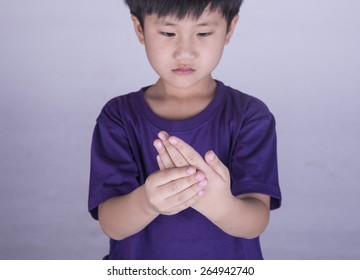 Boy with sore hands and fingers.