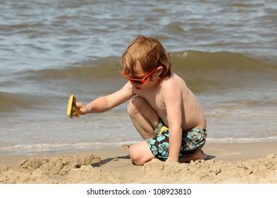 boy with spade