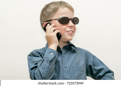 The boy speaking on the phone. White background.