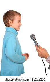 boy speaks into  microphone