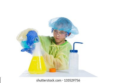 Boy spends experiments mixing different fluids and smoke gets