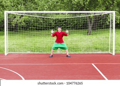 Boy standing in football goal