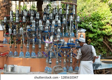 A boy standing in front of a cafe called (Shisha), Luxor, South Egypt, August 12, 2015