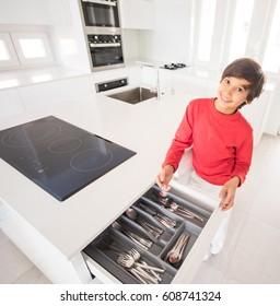 A boy standing in new modern kitchen