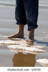Boy standing on the shore.