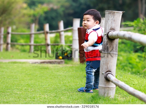Boy Standing Outside Bamboo Fence Stock Photo (Edit Now) 329018576