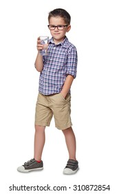 A boy stands with glass in hands on a white background.