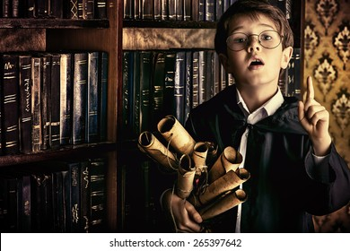A boy stands in the library by the bookshelves with many old books and holds old manuscripts. Educational concept. Science. Vintage style.