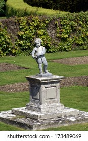 boy statue on column
