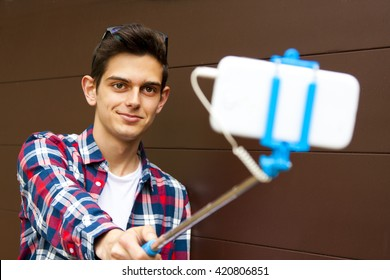 boy with the stick selfie