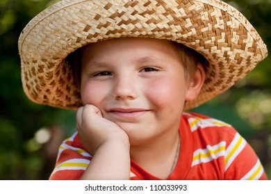 Boy in a straw hat and striped shirt