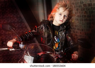 boy in the studio with motorcycle