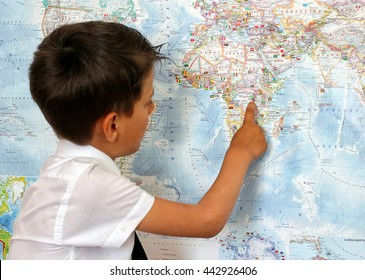 Boy studying a map of the world