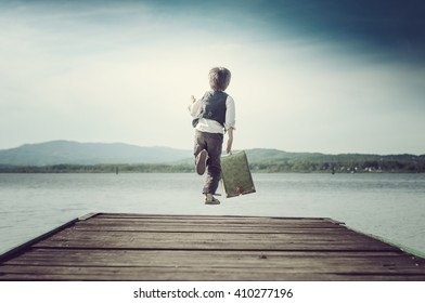 boy with a suitcase jumping with fishing pier