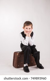 Boy with suitcase waiting , Travel concept , over grey background