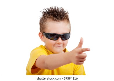 boy with sunglasses and hand in shape of gun, isolated on white background