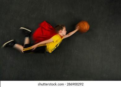 Boy superhero with a basketball, blur effect added