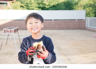 A boy with sweet potato