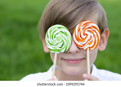 boy with sweets on a lolly popstick