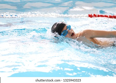boy swimmer  training in swimming pool