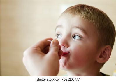 boy takes medicine syrup